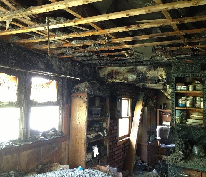 extensive fire damage to a living room in Jackson County