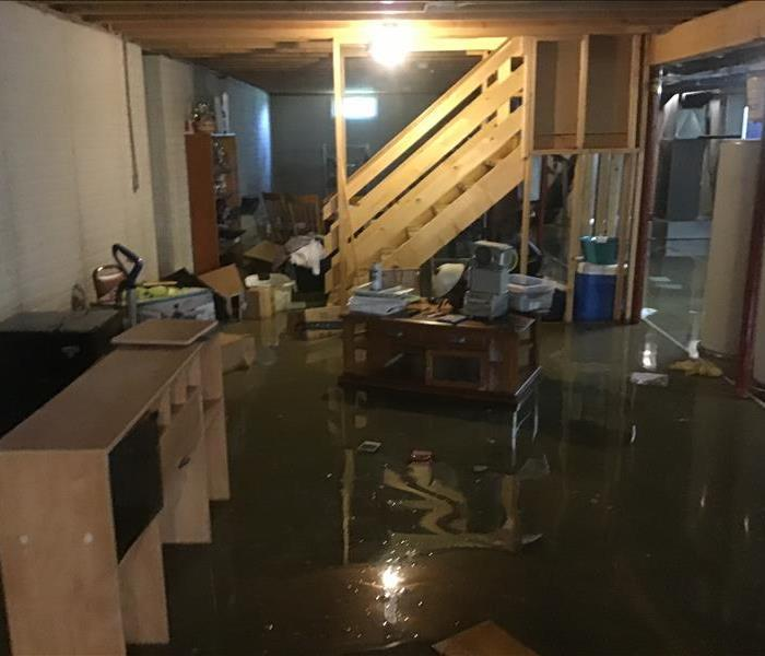 basement showing water covering the floor and contents floating